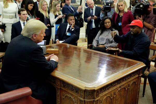 FILE - In this Oct. 11, 2018 file photo, rapper Kanye West speaks to President Donald Trump and others in the Oval Office of the White House in Washington.