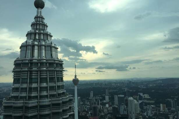 View from the 86th floor of one of the two Petronas Towers in Kuala Lumpur, Malaysia. Houston-based Cheniere Energy has signed a 20-year LNG supply deal with Petronas.