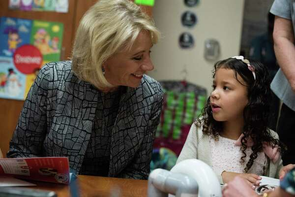 Education Secretary Betsy DeVos, left, talks to first-grader Teah Stanley at Hebron Harman Elementary School in Hanover, Md., in May as part of a field visit for the Federal Commission on School Safety.