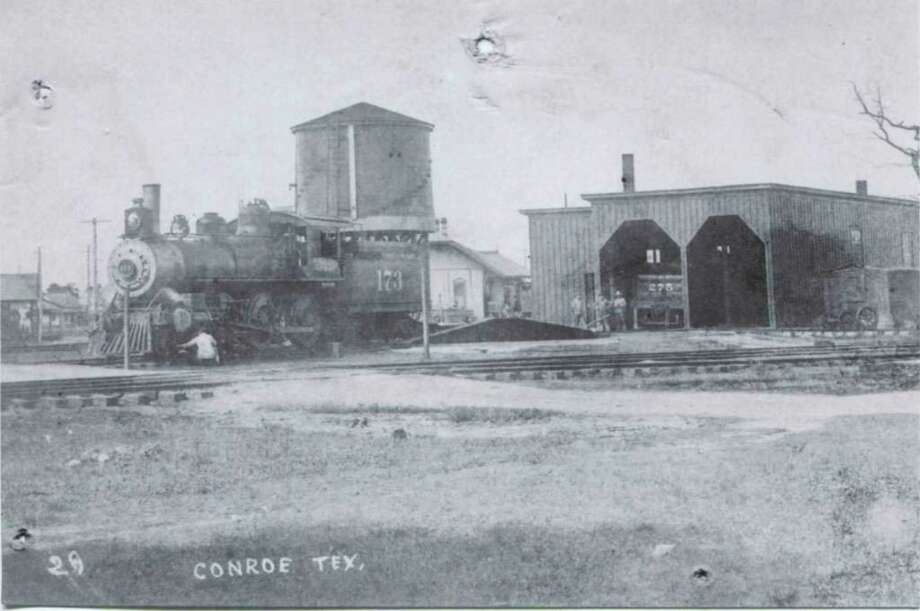 "The Santa Fe railroad roundhouse circa 1920 near Pacific Street in downtown Conroe. According to memories from Cedric N. Nutter that were written in ""A Silhouette of Conroe, Texas 1976"" on New Year's Eve the engineers at the Conroe roundhouse would blow the train horns and make lots of noise at midnight on New Year's Eve."