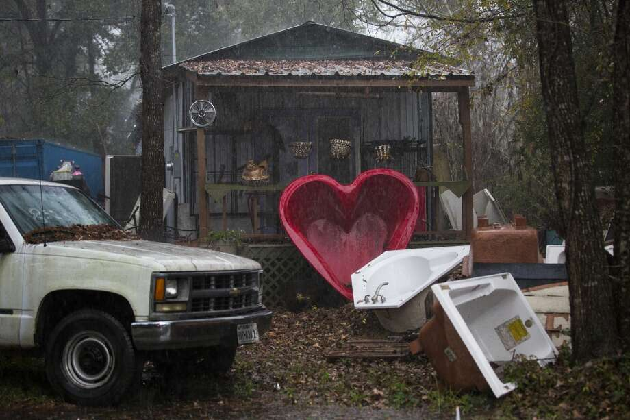 A home under a rain storm on Simmons Drive in Tamina. Photo: Marie D. De Jesús/Staff Photographer