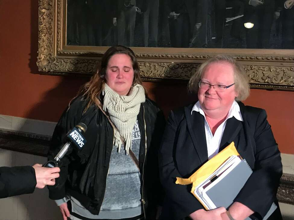 Luna's owner, Cade Saba, left, and her lawyer, Margaret Donnelly, speak to reporters after they reached an agreement with the city of Troy that will spare the dog from euthanasia in a biting incident.