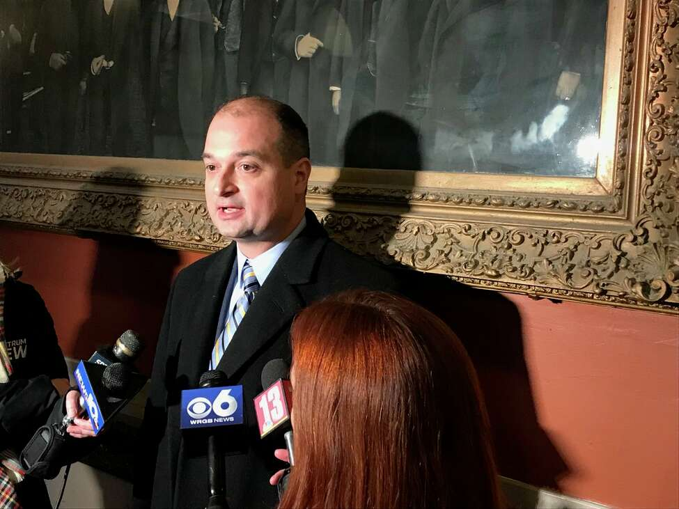 Jonathan Schaupf, a lawyer for Mohawk Hudson Humane Society, speaks to reporters after they reached an agreement with the city of Troy that will spare the dog from euthanasia in a biting incident.