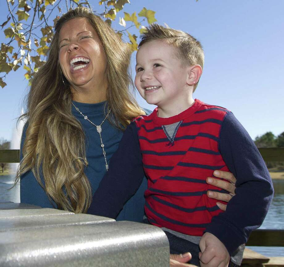 Erin Cones shares a laugh with her five-year-old son, Crew, during a visit to Rob Fleming Park, Saturday, Dec. 3, 2018, in The Woodlands. Erin, inspired by her son who recently completed leukemia treatment, raised $120,000 for the Leukemia and Lymphoma Society's Man & Woman of the Year Campaign. Photo: Jason Fochtman, Houston Chronicle / Staff Photographer / © 2018 Houston Chronicle