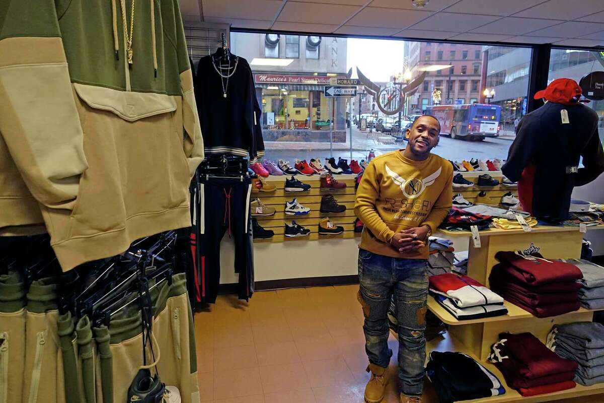 Angelo Maddox, owner of Fresh & Fly, poses inside his store on South Pearl Street on Monday, Dec. 17, 2018, in Albany, N.Y. (Paul Buckowski/Times Union)