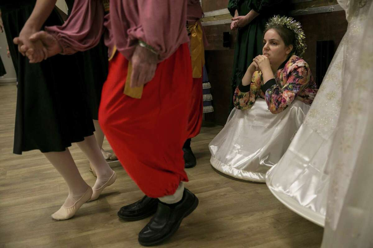 """Heather Miller waits in the wings for her scene during a rehearsal for the Alamo City Dance Company's sensory-friendly staging of """"The Nutcracker."""""""