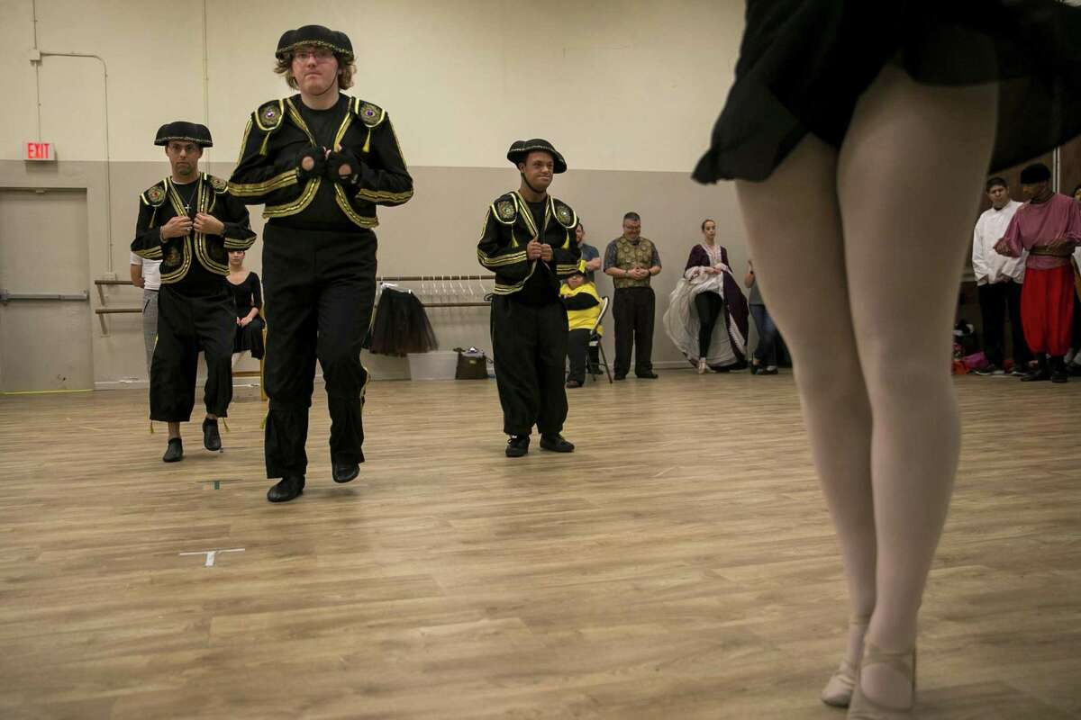 """Cast members rehearse the journey to the land of sweets for the Alamo City Dance Company's sensory-friendly production of """"The Nutcracker."""" The company is teaming up with Eva's Heroes, which works with people with special needs, for the pared-down production of the holiday classic."""