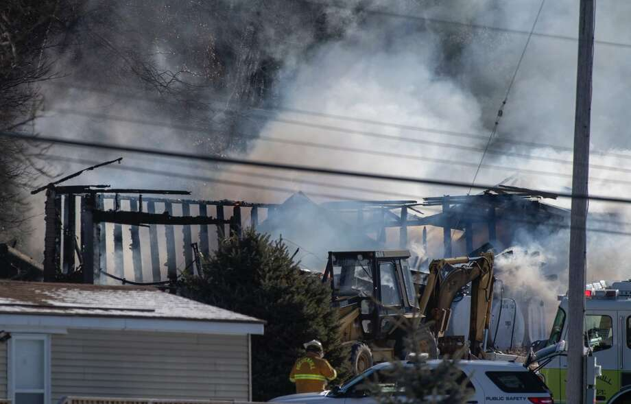 A storage building was consumed by flames on Mohameds Farm Way on Tuesday. It was unclear what caused the fire, which destroyed the building. The structure is located near a Muslim cemetery on Snyders Lake Road. Photo: Skip Dickstein / Times Union