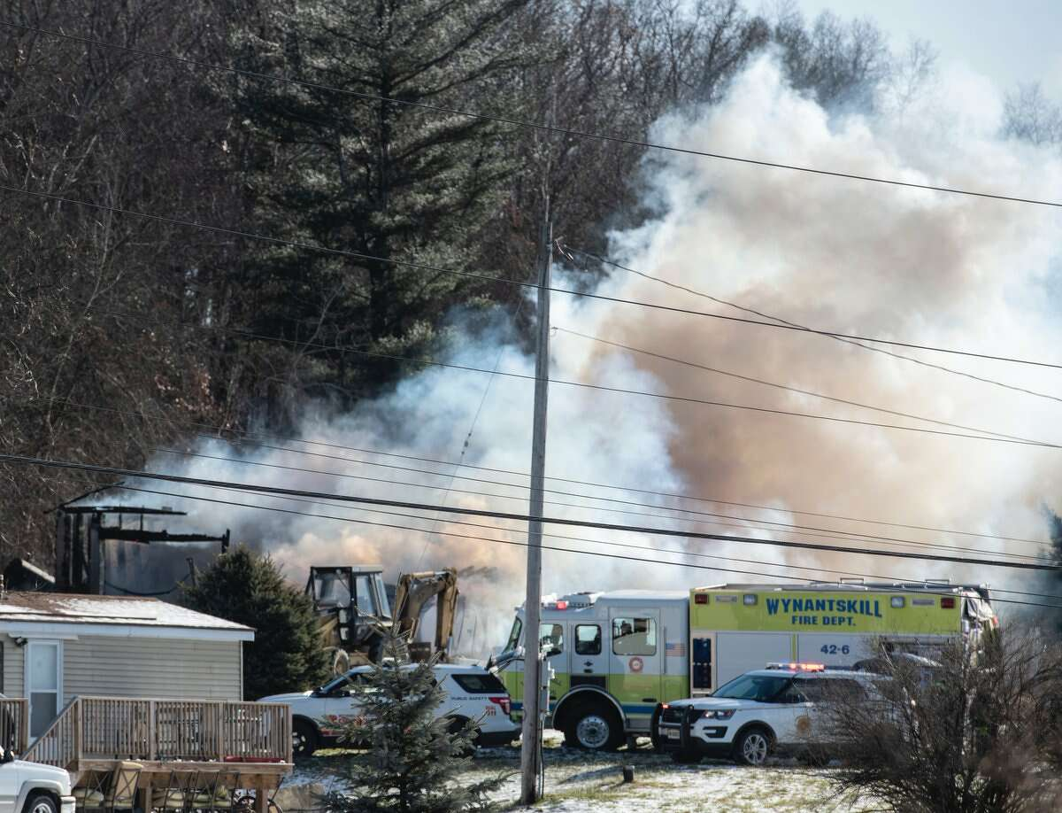 A storage building was consumed by flames on Mohameds Farm Way on Tuesday. It was unclear what caused the fire, which destroyed the building. The structure is located near a Muslim cemetery on Snyders Lake Road.