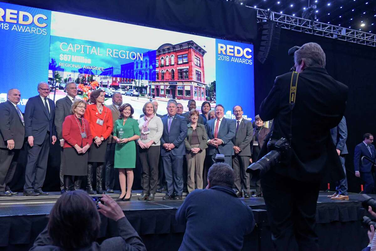 Elected officials and business leaders representing the Capital Region, pose for a photo with the New York State Lt. Governor Kathy Hochul, center in green, during the REDC Awards at the Albany Capital Center on Tuesday, Dec. 18, 2018, in Albany, N.Y. (Paul Buckowski/Times Union)