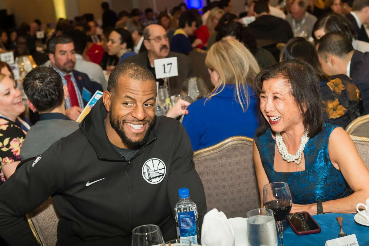 Andre Iguodala and Melinda Yee Franklin attend Warriors Holiday Hoops Luncheon on December 11th 2018 at Fairmont Hotel SF in San Francisco.