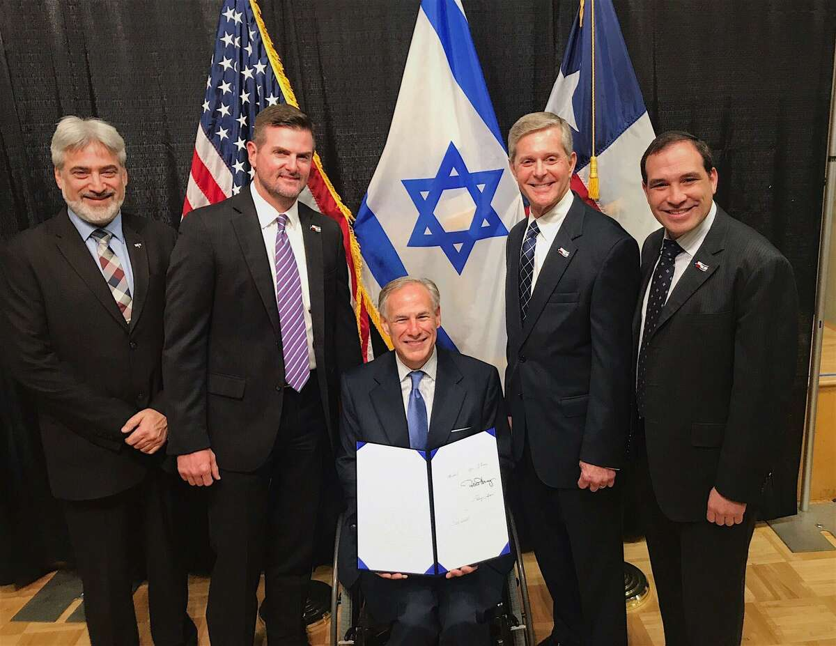 State Sen. Brandon Creighton, second from left, traveled to Israel to deliver a pen to Prime Minister Benjamin Netanyahu. The pen was used by Texas Gov. Greg Abbott to sign House Bill 89, also known as the Anti=BDS (Boycott, Divestments and Sanctions) bill, which prohibits the state from contracting with and investing in companies that boycott Israel.