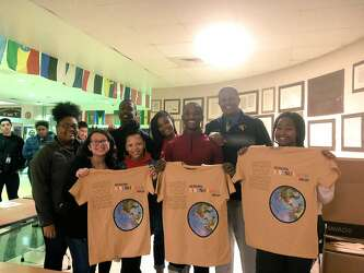 1b6c3c3fa1be As promised: Travis Scott delivers custom T-shirts to Houston high school  seniors - Houston Chronicle