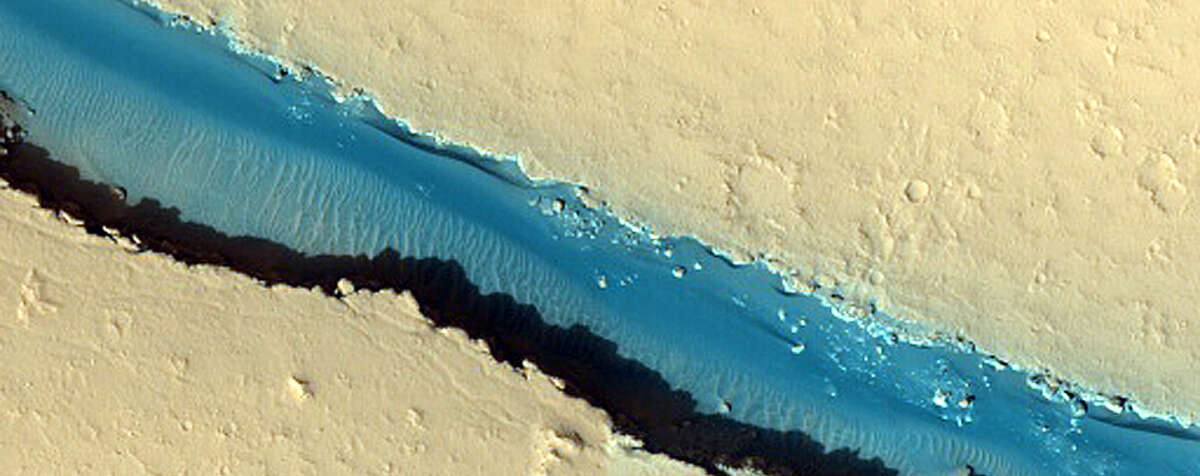 New photos published in December that were taken onboard the Mars Reconnaissance Orbiter with the High-Resolution Imaging Science Experiment show how eerily Earth-like yet pleasantly alien Mars exactly is.