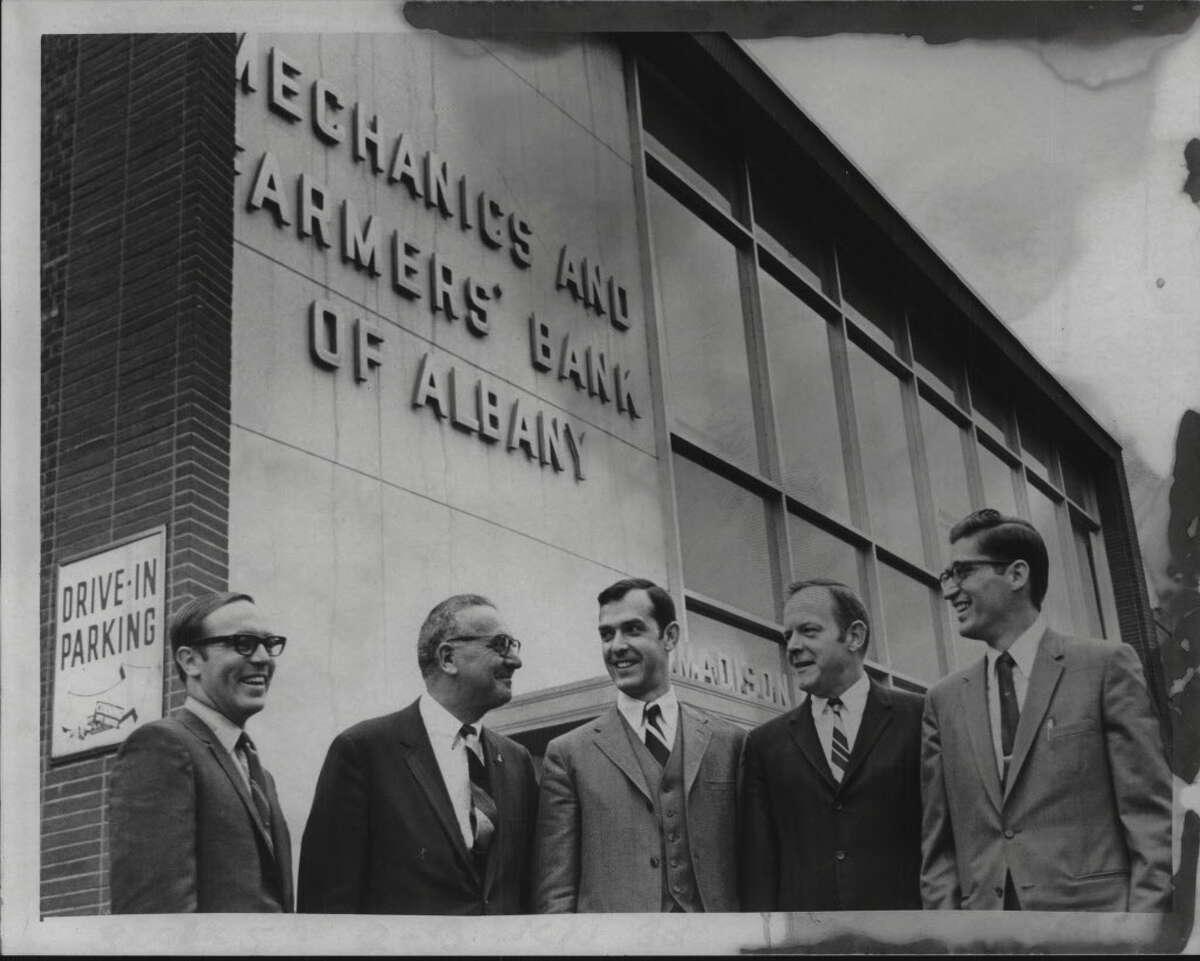 Officers pose outside Mechanics & Farmers Bank, Albany, New York - Richard Brackett, Russell E. Johnson, William G. Treston, John F. Hicket, Edward Wagner. October 1969 (Bob Paley/Times Union Archive)