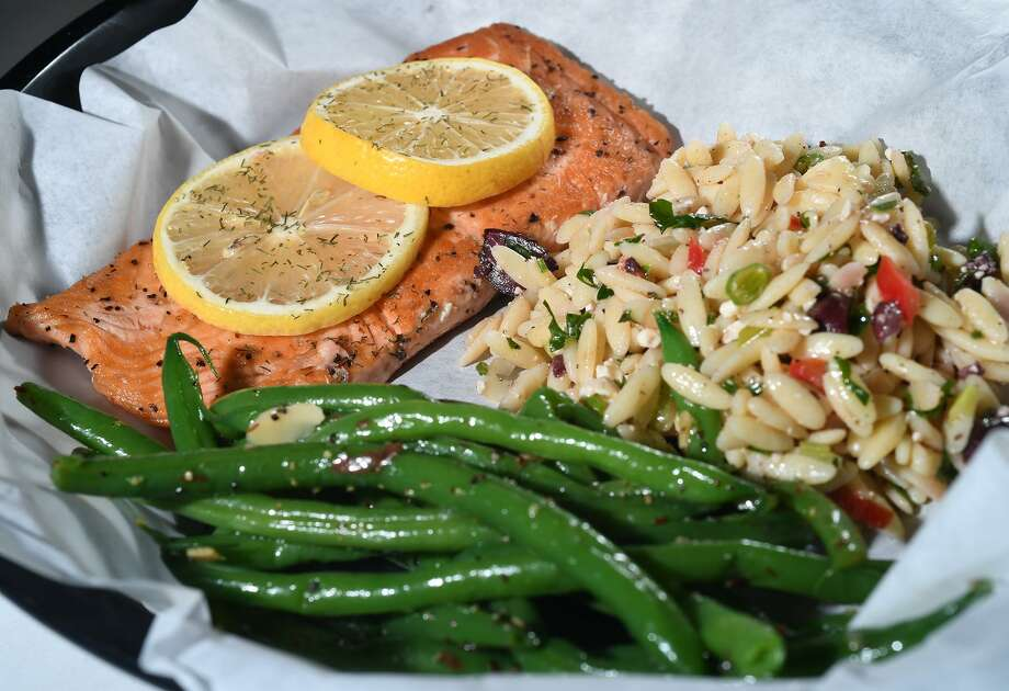 The grilled salmon at K2 in Beaumont is served with great beans and a Greek orzo salad.   Photo taken Wednesday, 12/12/18 Photo: Guiseppe Barranco/The Enterprise, Photo Editor / Guiseppe Barranco ©