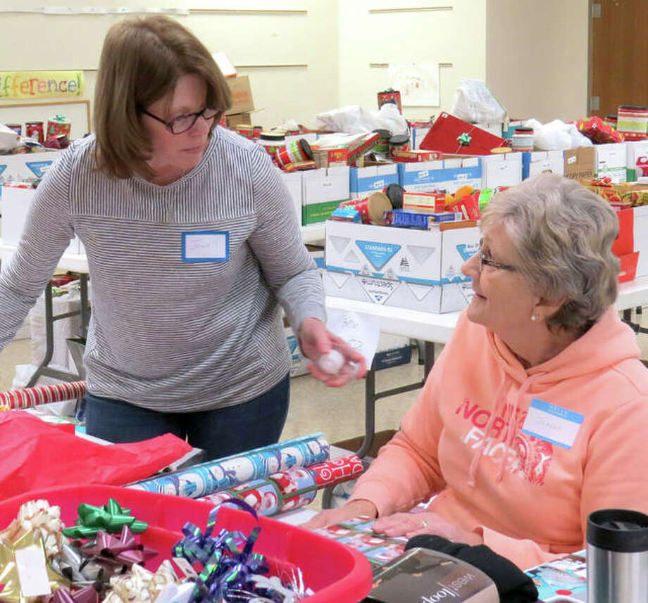 Volunteers spent several days wrapping presents to be given with food boxes to Troy residents in need. Photo: Carol Arnett | For The Intelligencer