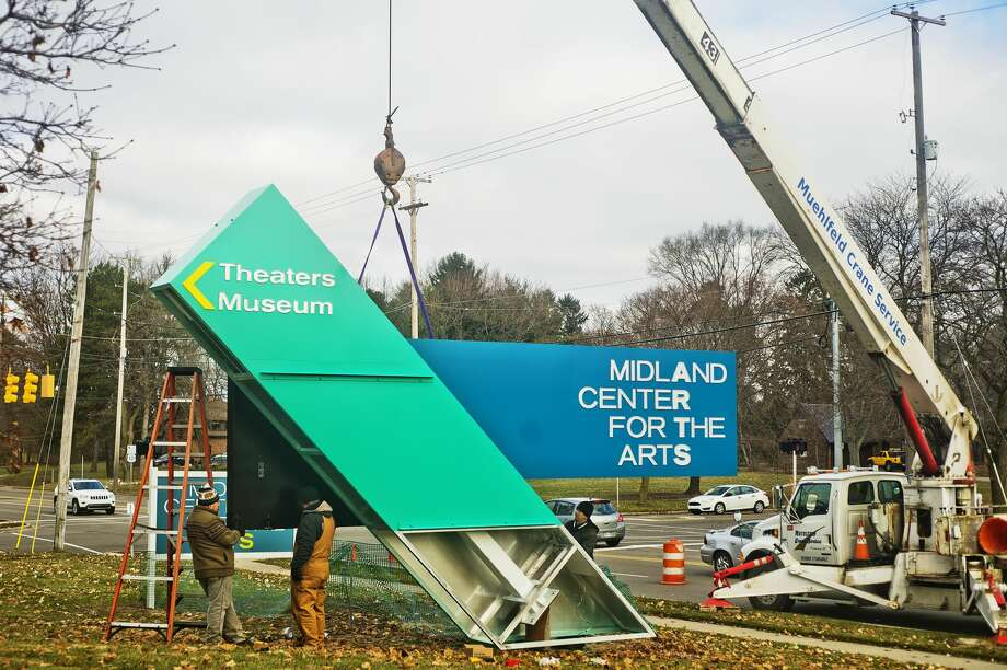 A brand new sign for the Midland Center for the Arts featuring two large LED monitors is installed Tuesday, Dec. 18, 2018. The sign was designed by Empire Architectural Design, which is based in Midland. (Katy Kildee/kkildee@mdn.net) Photo: (Katy Kildee/kkildee@mdn.net)