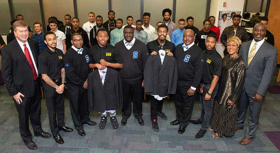 A representation of SIUE's Collegiate 100 Chapter and Goal-Oriented African American Men Excel (GAME) were at the Phi Beta Sigma Fraternity's presentation of business attire. Shown left to right on the first row: Vice Chancellor for Student Affairs Jeffrey Waple, Collegiate 100 member Derrick Miles, Phi Beta Sigma Vice President James Brown, Collegiate 100 member William Mackey, Phi Beta Sigma Member Freddie Wills, Collegiate 100 President Braxton McCarroll, Phi Beta Sigma Chaplain Steve Roberts, Collegiate 100 Corresponding Secretary David Robinson, SOAR Director Earleen Patterson, and SOAR Coordinator of Retention Darryl Cherry. Photo: For The Intelligencer