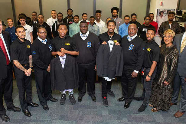 A representation of SIUE's Collegiate 100 Chapter and Goal-Oriented African American Men Excel (GAME) were at the Phi Beta Sigma Fraternity's presentation of business attire. Shown left to right on the first row: Vice Chancellor for Student Affairs Jeffrey Waple, Collegiate 100 member Derrick Miles, Phi Beta Sigma Vice President James Brown, Collegiate 100 member William Mackey, Phi Beta Sigma Member Freddie Wills, Collegiate 100 President Braxton McCarroll, Phi Beta Sigma Chaplain Steve Roberts, Collegiate 100 Corresponding Secretary David Robinson, SOAR Director Earleen Patterson, and SOAR Coordinator of Retention Darryl Cherry.