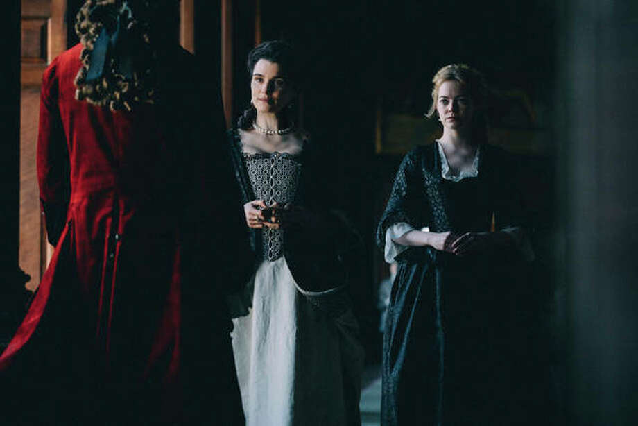"This image released by Fox Searchlight Films shows Rachel Weisz and Emma Stone, right, in a scene from the film ""The Favourite."" On Thursday, Dec. 6, 2018, the film was nominated for a Golden Globe award for best motion picture musical or comedy. The 76th Golden Globe Awards will be held on Sunday, Jan. 6. Photo: Atsushi Nishijima/Fox Searchlight Films Via AP"