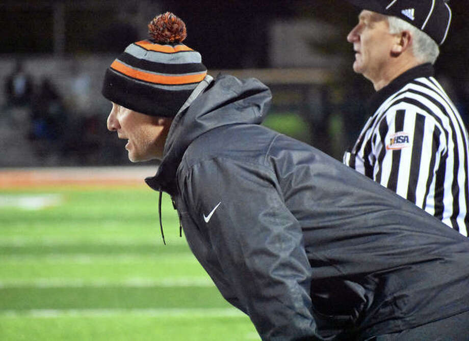 Edwardsville coach Matt Martin looks on from the sidelines during a regular-season game for the Tigers.