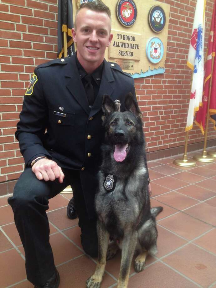 Officer John Carlson and his police dog, Bane, shown at Bane's 2017 swearing in. Photo: Contributed /