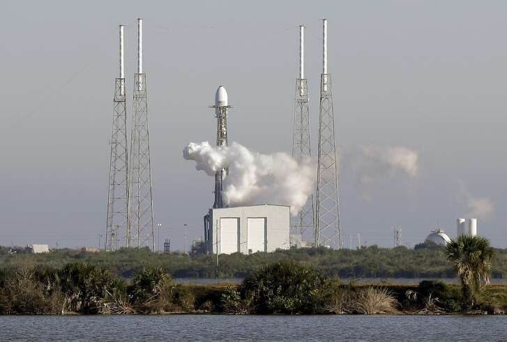 A Falcon 9 SpaceX rocket, stands ready at space launch complex 40, shortly before the launch was scrubbed because of a technical issue at the Cape Canaveral Air Force Station in Cape Canaveral, Fla., Tuesday, Dec. 18, 2018. The payload on the rocket is the U.S. Air Force's first Global Positioning System III space vehicle and the system will augment 31 current operational GPS satellites. (AP Photo/John Raoux)
