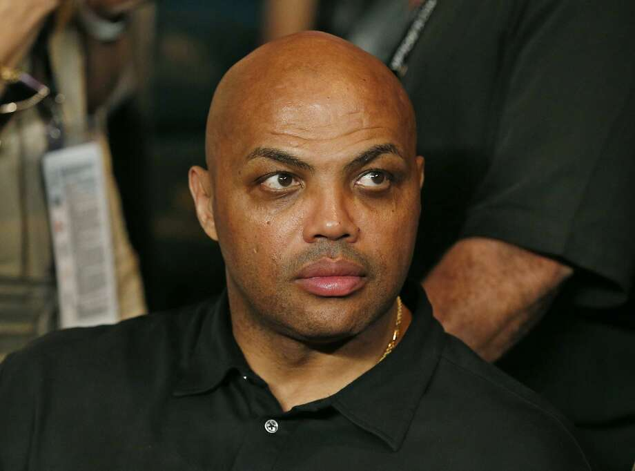 "FILE - In this May 2, 2015, file photo, Charles Barkley joins the crowd before the start of the world welterweight championship bout between Floyd Mayweather Jr. and Manny Pacquiao in Las Vegas. A chance meeting in a hotel lobby sparked an unlikely friendship between former NBA star Charles Barkley and a cat litter scientist in Iowa. The story has been shared widely since it was told last week by the scientist's daughter on ""Only A Game,"" an NPR sports show produced by Boston-based WBUR. Shirley Wang says that her father, Lin Wang, approached Barkley at a hotel while on a business trip. The two began talking, got dinner and exchanged numbers. They would meet up over the years to watch basketball games or hang out on the set of Barkley's show. When Lin Wang died this year, Barkley showed up at his funeral in Iowa to the surprise of other attendees. (AP Photo/John Locher, File) Photo: John Locher, Associated Press"