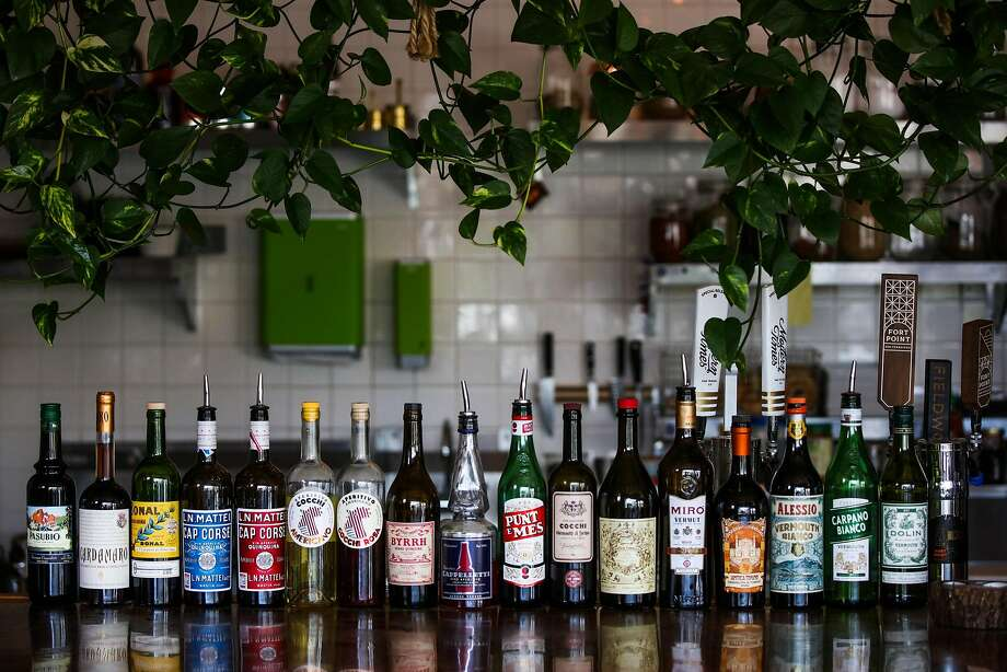 Bottles of alcohol line the bar at Orsons Belly cafe in San Francisco on July 4. Photo: Gabrielle Lurie / The Chronicle