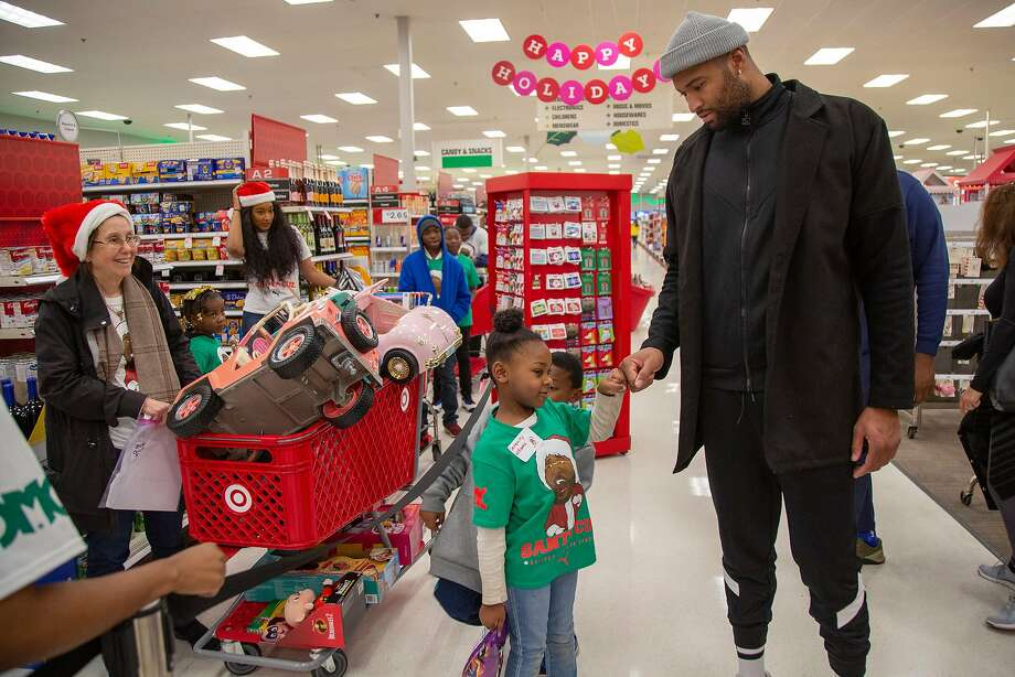 The Warriors' DeMarcus Cousins greets children attending his Santa Cuz shopping spree at Target in Mobile, Ala. Photo: Jeff Haller / Special To The Chronicle