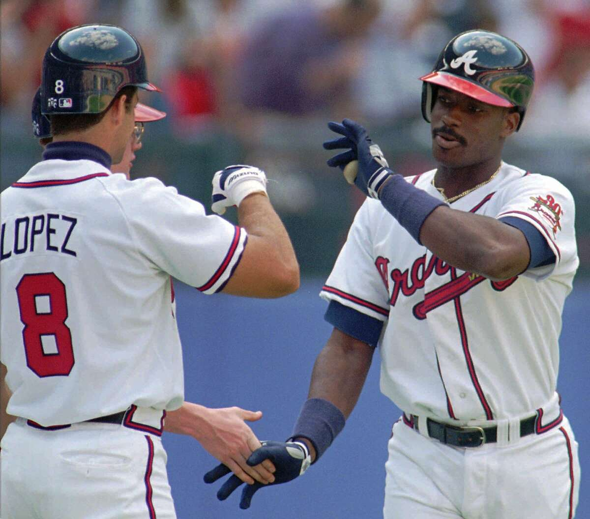 Atlanta Braves first baseman Fred McGriff, right, is congratulated by catcher Javier Lopez on his first homer of the season Wednesday, April 26, 1995 in Atlanta. The Braves defeated the San Francisco Giants 12-5 with McGriff getting two homers. (AP Photo/John Bazemore) ALSO Ran on: 07-29-2007 Fred McGriff went to the struggling Braves in a trade with the Padres in 1993 and helped his new team to a 104-win season. The 2007 Braves are looking hard at making a trade for the Rangers Mark Teixeira. Ran on: 07-29-2007
