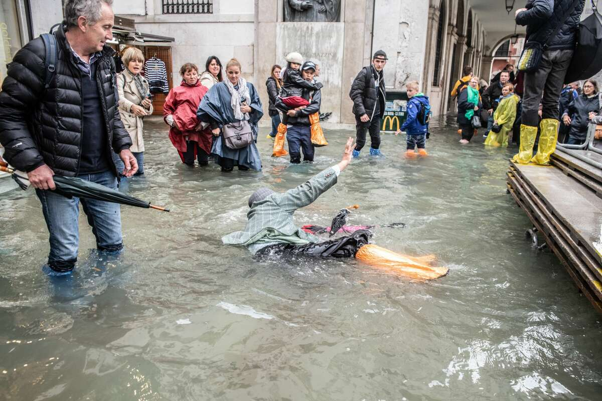 Disappointing photos show the crowds, flooding and cruise ship pollution - this is what Venice really looks like.