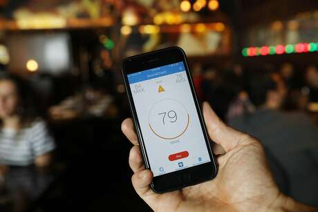John Mortimer, Zero Zero general manager, displays the SoundPrint app on his phone at Zero Zero. Photo: Lea Suzuki / The Chronicle