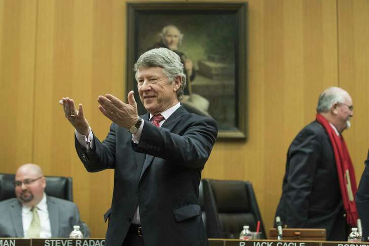 County Judge Ed Emmett stands to greet visitors to take a photo following a proclaimation presentation during Harris County Commissioners Court on Tuesday, Dec. 18, 2018, in Houston. After 11 years as County Judge, it was Emmett's final Commissioners Court meeting before stepping down in January.