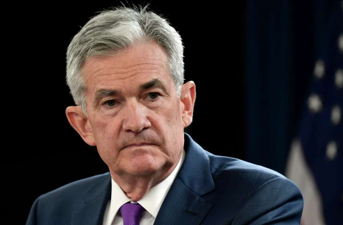 FILE- In this Sept. 26, 2018, file photo Federal Reserve Chairman Jerome Powell listens to a question during a news conference in Washington. The Federal Reserve is poised Wednesday, Dec. 19, to raise its key interest rate for the fourth time this year. But beyond that, its plans are shrouded in uncertainty. (AP Photo/Susan Walsh, File)