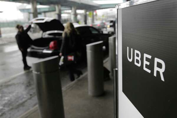 A sign marks a pick up point for the Uber car service at LaGuardia Airport in New York.