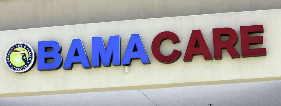 File- This May 11, 2017, file photo shows an Obamacare sign being displayed on the storefront of an insurance agency in Hialeah, Fla. Change Happens, a Houston non-profit community group, has been awarded just over $400,000 in a federal grant to assist in the upcoming enrollment efforts for 2020 plans. It is only one of two groups to receive money to help with enrollment in the state of Texas.(AP Photo/Alan Diaz, File) Photo: Alan Diaz, STF / Associated Press / Copyright 2017 The Associated Press. All rights reserved.