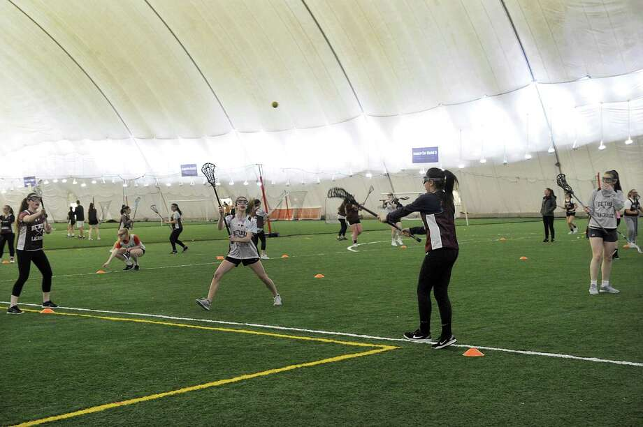 Members of the Bethel High School Varsity and Junior Varsity Lacrosse teams practice at the Danbury Sports Dome Monday, March 26, 2018. Photo: Carol Kaliff / Hearst Connecticut Media / The News-Times