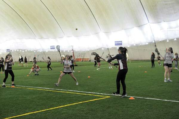 Members of the Bethel High School Varsity and Junior Varsity Lacrosse teams practice at the Danbury Sports Dome Monday, March 26, 2018.