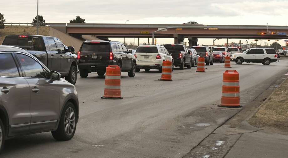 Traffic backs up at the light at Big Spring and Loop 250 heading north 12/17/18 as construction north of the loop has closed one lane of the roadway. Tim Fischer/Reporter-Telegram Photo: Tim Fischer/Midland Reporter-Telegram