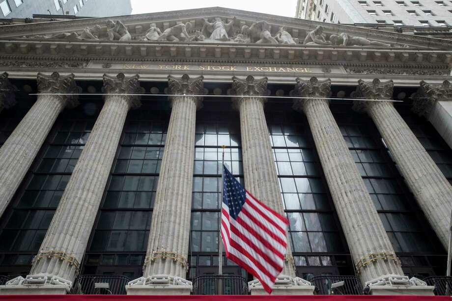 FILE - In this Nov. 20, 2018, file photo an American flag flies outside New York Stock Exchange. Stocks are opening solidly higher on Wall Street as the market claims back some of the ground it lost in steep drops over the previous two days. Technology and industrial stocks were among the biggest winners in early trading Tuesday, Dec. 18. (AP Photo/Mary Altaffer, File) Photo: Mary Altaffer / Copyright 2018 The Associated Press. All rights reserved.