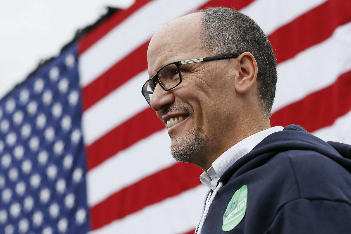 FILE - In this Nov. 4, 2018, file photo, Tom Perez, Chairman of the Democratic National Committee, waits to speak during an early voting campaign event in Cincinnati. Democratic National Committee officials and a group of state party leaders are set Tuesday to hash out an increasingly ugly fight over how the party manages and pays for the voter data used in campaigns. (AP Photo/John Minchillo, File)