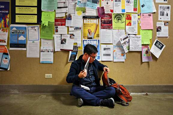 City College student Wayne Leong studies for his Bridge to Biotech final in the corridor in the Science Hall  on Tuesday, December 18,  2018  in San Francisco, Calif.