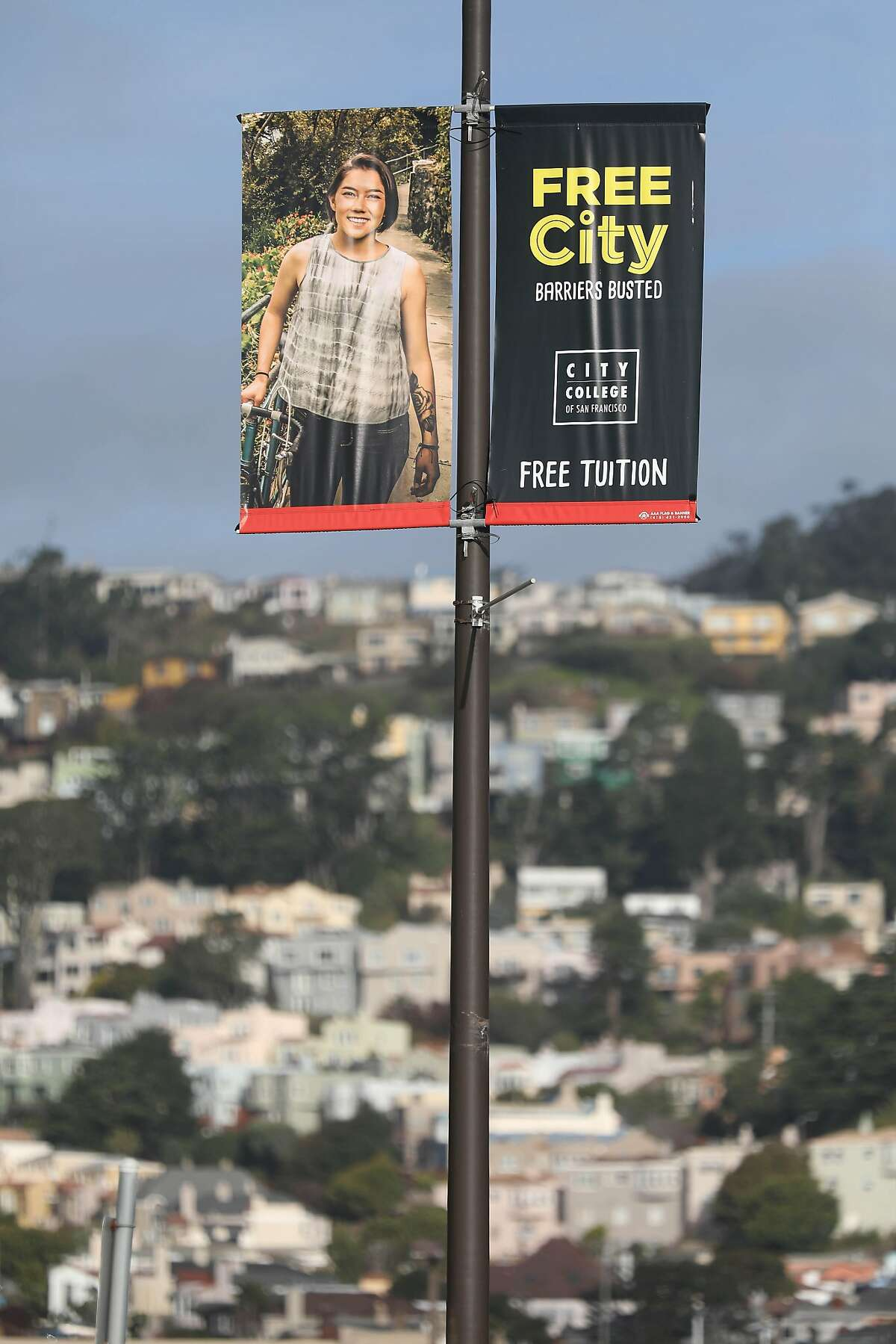 A free City College banner hangs on a light pole along Frida Kahlo Way on Tuesday, December 18, 2018 in San Francisco, Calif.