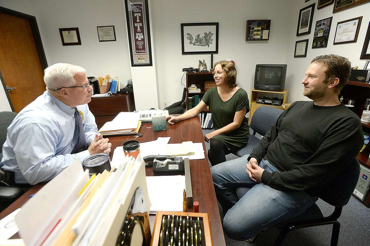 Erin Page and Sean Hill talk with Vidor Police Chief Rod Carroll in his office on Tuesday, October 23, 2018. Carroll has been re-investigating the alleged murder of Page's mother, which inspired the film