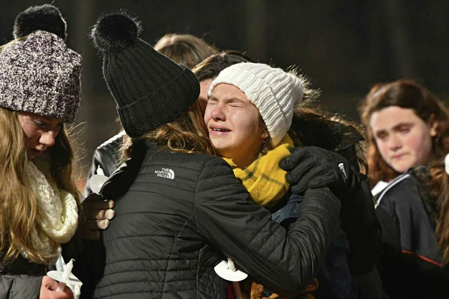 """Classmates get emotional while singing """"Silent Night"""" as they attend a vigil to honor seventh-grader Emma Jones at the Ballston Spa High School football field on Tuesday, Dec. 18, 2018 in Ballston Spa, N.Y. Jones was killed as part of what police say was a murder-suicide. (Lori Van Buren/Times Union) Photo: Lori Van Buren, Albany Times Union / 20045759A"""