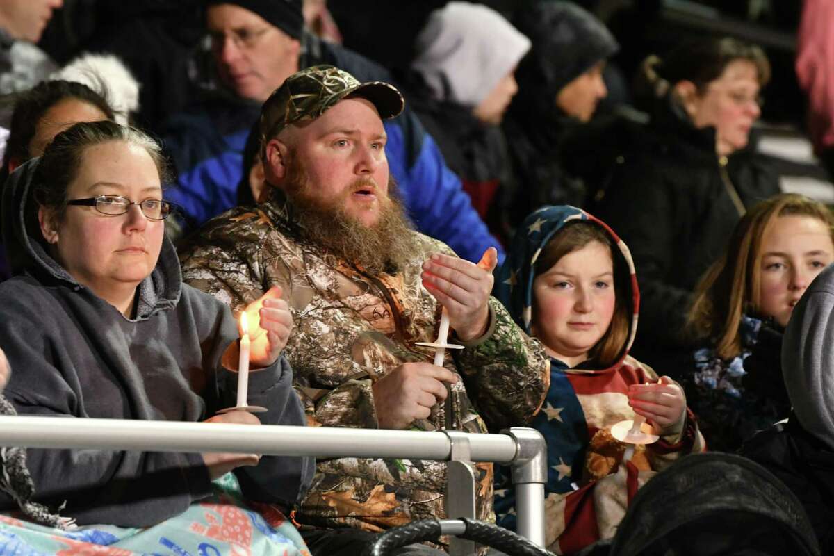 People light candles during a vigil to honor seventh-grader Emma Jones at the Ballston Spa High School football field on Tuesday, Dec. 18, 2018 in Ballston Spa, N.Y. Jones was killed as part of what police say was a murder-suicide. (Lori Van Buren/Times Union)