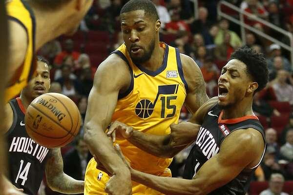 Rockets guard Brandon Knight,right, battles Jazz forward Derrick Favors on Monday night.