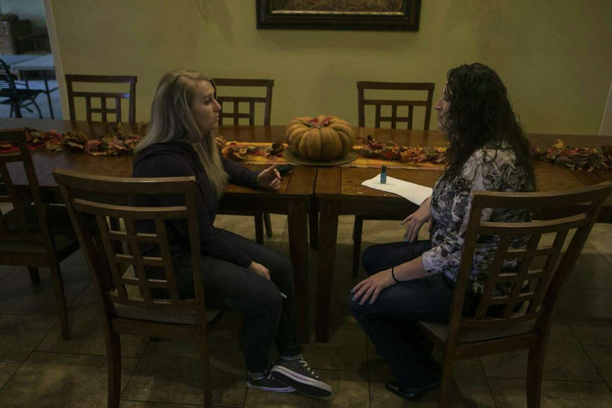 Katie Scott chats with Jennifer Woodbury who recently arrived at Grace House of San Antonio, Friday, Nov. 9, 2018. Grace House of San Antonio is a faith-based residential home for women who have been incarcerated, struggling with addiction and provides a structured environment with classes for recovery from addiction, career skills and scripture, along with daily devotionals and shared responsibilities throughout the house.
